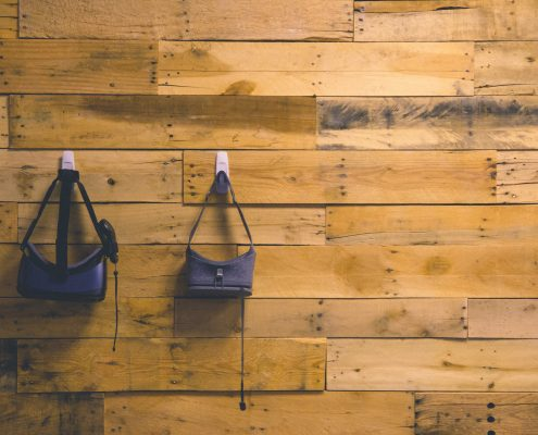 VR Googles hanging on a wooden wall
